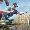 Robert Balzano helps bring in a fish caught by Jake Dunn, 7, left, and Matthew Balsono, 7, during Saturday's fishing derby at Tom Frost Reservoir  sponsored by the Broomfield Open Space Foundation in cooperation with the Colorado Division of Wildlife and the City and County of Broomfield.<br /> May 7, 2011<br /> staff photo/David R. Jennings