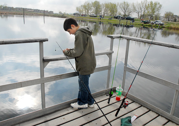 Christopher Morgen, 11, puts bait on his hook while fishing from the dock during the Fishing Derby sponsored by the Colorado Division of Wildlife and Broomfield Open Space Foundation at Tom Frost Reservoir on Saturday<br /> May 14, 2010<br /> Staff photo/ David R. Jennings