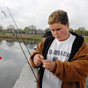 Donny Lingerfelt, 11, puts bait on his hook  during the Fishing Derby sponsored by the Colorado Division of Wildlife and Broomfield Open Space Foundation at Tom Frost Reservoir on Saturday<br /> May 14, 2010<br /> Staff photo/ David R. Jennings