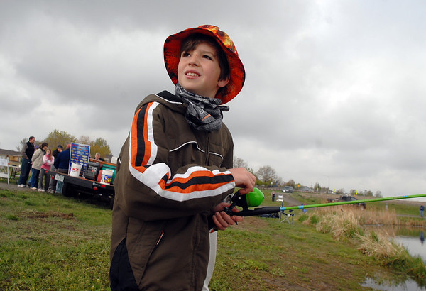 Brenden Oren, 11, fishes with a free pole during the Fishing Derby sponsored by the Colorado Division of Wildlife and Broomfield Open Space Foundation at Tom Frost Reservoir on Saturday. All children received a free pole after registering for the derby.<br /> May 14, 2010<br /> Staff photo/ David R. Jennings