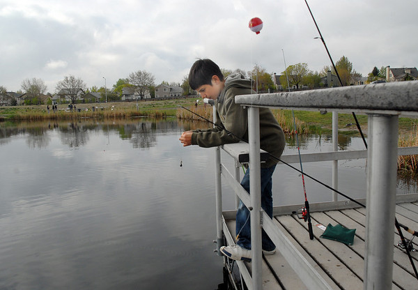 Christopher Morgen, 11, puts bait on his hook while fishing from the dock  during the Fishing Derby sponsored by the Colorado Division of Wildlife and Broomfield Open Space Foundation at Tom Frost Reservoir on Saturday.<br /> May 14, 2010<br /> Staff photo/ David R. Jennings