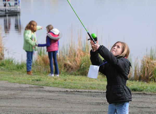 Celeste Crosbie, 8, practices casting during the Fishing Derby sponsored by the Colorado Division of Wildlife and Broomfield Open Space Foundation at Tom Frost Reservoir on Saturday<br /> May 14, 2010<br /> Staff photo/ David R. Jennings