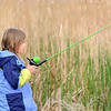 Tanna Tennyson, 9, patiently fishes next to cattails while fishing during the Fishing Derby sponsored by the Colorado Division of Wildlife and Broomfield Open Space Foundation at Tom Frost Reservoir on Saturday<br /> May 14, 2010<br /> Staff photo/ David R. Jennings