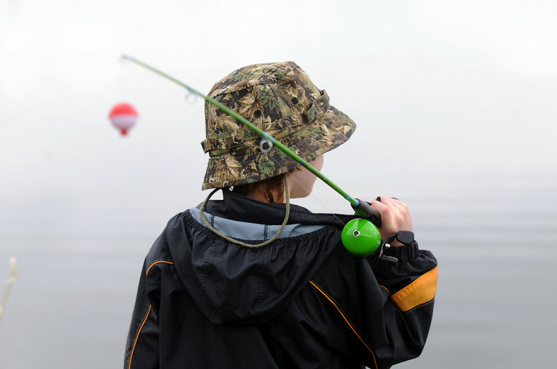 Micah Oren, 9, studies where to cast his line during the Fishing Derby sponsored by the Colorado Division of Wildlife and Broomfield Open Space Foundation at Tom Frost Reservoir on Saturday.<br /> May 14, 2010<br /> Staff photo/ David R. Jennings