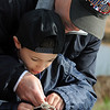 Matthew Balsano, 6, and his father Rob learn to make a knot used in fishing during the Fishing Derby sponsored by the Colorado Division of Wildlife and Broomfield Open Space Foundation at Tom Frost Reservoir on Saturday<br /> May 14, 2010<br /> Staff photo/ David R. Jennings
