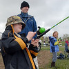 Micah Oren, 9, fishes with his father Bret during the Fishing Derby sponsored by the Colorado Division of Wildlife and Broomfield Open Space Foundation at Tom Frost Reservoir on Saturday<br /> May 14, 2010<br /> Staff photo/ David R. Jennings