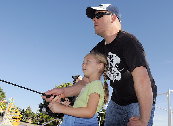 Ava Nordgren, 6, fishing with her father Collin during Fishing at the Bay on Saturday.<br /> September 24, 2011<br /> staff photo/ David R. Jennings