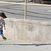 Hayden Wiegert, 3, runs while watching his shadow after taking a break from fishing for the first time during Fishing at the Bay on Saturday.<br /> September 24, 2011<br /> staff photo/ David R. Jennings