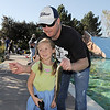 Ava Nordgren, 6, poses for a picture with her father Collin holding her fish during Fishing at the Bay on Saturday.<br /> September 24, 2011<br /> staff photo/ David R. Jennings