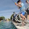 Lucas Wiliams, 6, tries his skill at fishing during Fishing at the Bay on Saturday.<br /> September 24, 2011<br /> staff photo/ David R. Jennings