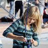 Caitlin Welch, 8, gets her pole ready after catching a fish during Fishing at The Bay on Saturday.<br /> <br /> Sept. 26, 2009<br /> Staff photo/David R. Jennings