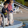 Brothers Ethan White, 3, left, and Kyle, 4, try to catch fish in the pool during Fishing at The Bay on Saturday.<br /> <br /> Sept. 26, 2009<br /> Staff photo/David R. Jennings