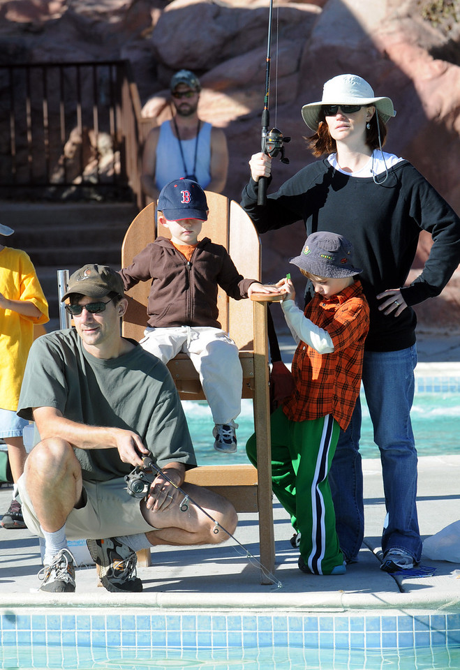 The Artmann family with Mike, left, Ryan, 3, Sean, 6, and Amy test their skills at fishing during Fishing at the Bay on Saturday at The Bay Aquatic Park.<br /> <br /> September 25, 2010<br /> staff photo/David R. Jennings