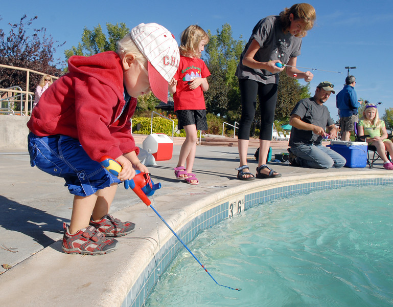 Tristan Lamb, 2, explores a different method of fishing during  Fishing at the Bay on Saturday at The Bay Aquatic Park.<br /> <br /> September 25, 2010<br /> staff photo/David R. Jennings