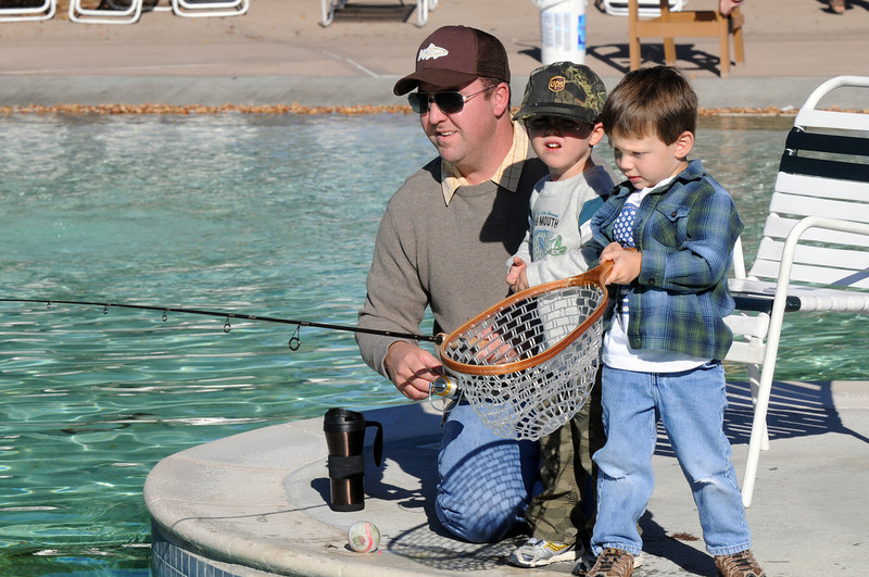 Kevin Forant and his son Ryan, 3, fish while Garrett Wolkin, 3, is ready with a net if a fish is caught during Fishing at the Bay on Saturday.<br /> <br /> September 25, 2010<br /> staff photo/David R. Jennings