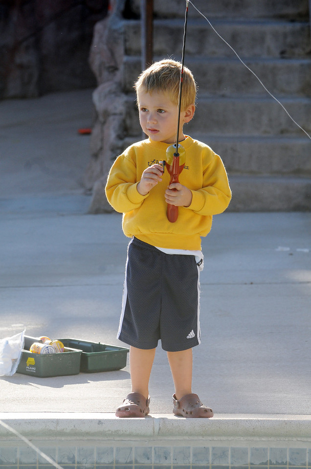 """Chase Branstatter, 3, stand at the edge of the water slide pool fishing for, as his father said, """" The elusive waterslide trout, don't know where they got them."""" during Fishing at the Bay on Saturday.<br /> <br /> September 25, 2010<br /> staff photo/David R. Jennings"""