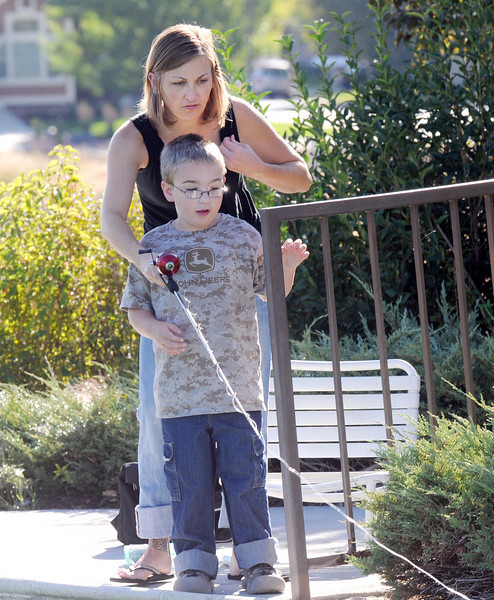 Reegan Curtis, 5, and his mother Heather watch for fish to bite during Fishing at the Bay on Saturday.<br /> <br /> September 25, 2010<br /> staff photo/David R. Jennings