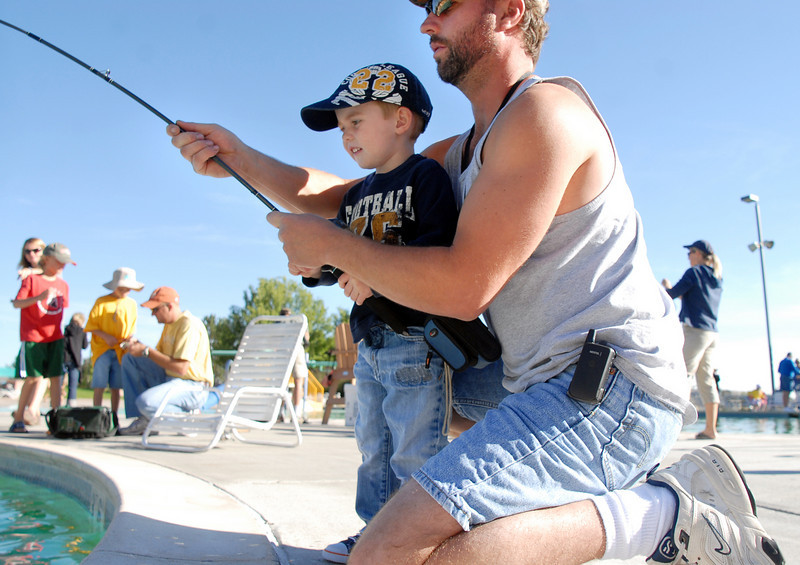 Dylan Evelsizer, 3, and his father Sven fish together during Fishing at the Bay on Saturday.<br /> <br /> September 25, 2010<br /> staff photo/David R. Jennings