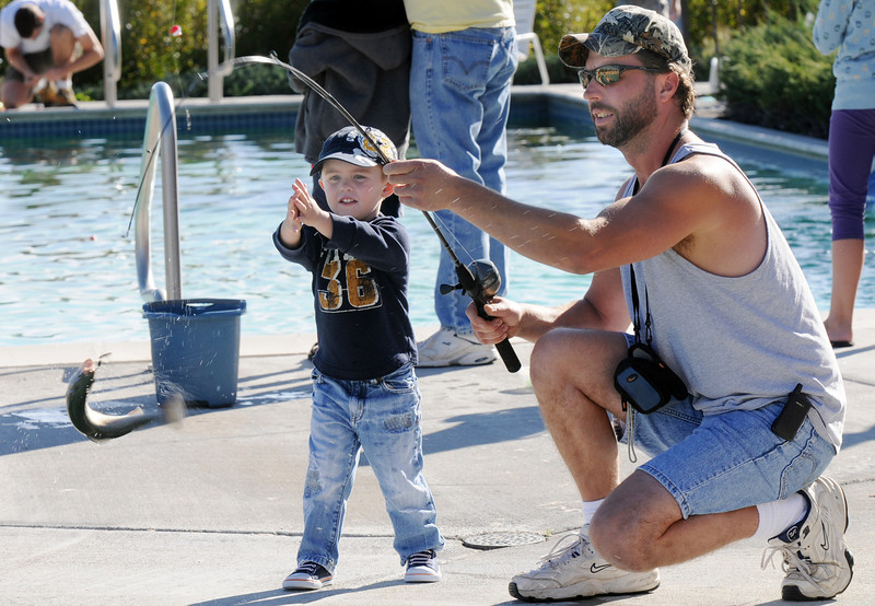 Sven Evelsizer and his son Dylan, 3, reel in their thrid catch of the day during Fishing at the Bay on Saturday.<br /> <br /> September 25, 2010<br /> staff photo/David R. Jennings