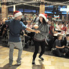 "Hannah Vincent and Mikey Ruiz with Break EFX  lead a flash mob of over 200 people dancing to Mariah Carey's song ""All I want for Christmas is you"" surrounding shoppers in the food court of FlatIron Crossing mall on Thursday. Dancers from Artistic Fusion Dance Academy participated in the flash mob.<br /> December  9, 2010<br /> staff photo/David R. Jennings"