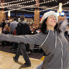 "Break EFX dancer Hannah Vincent begins dancing leading over 200 people to dance in a flash mob to Mariah Carey's song ""All I want for Christmas is you"" in the food court of FlatIron Crossing mall on Thursday. Dancers in the flash mob were from Artistic Fusion Dance Academy and Break EFX Boulder/Denver. <br /> December  9, 2010<br /> staff photo/David R. Jennings"