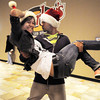 "Break EFX dancers Crista Lewis and Herb Neil begin dancing leading over 200 people to dance in a flash mob to Mariah Carey's song ""All I want for Christmas is you"" in the food court of FlatIron Crossing mall on Thursday. Dancers in the flash mob were from Artistic Fusion Dance Academy and Break EFX Boulder/Denver. <br /> December  9, 2010<br /> staff photo/David R. Jennings"