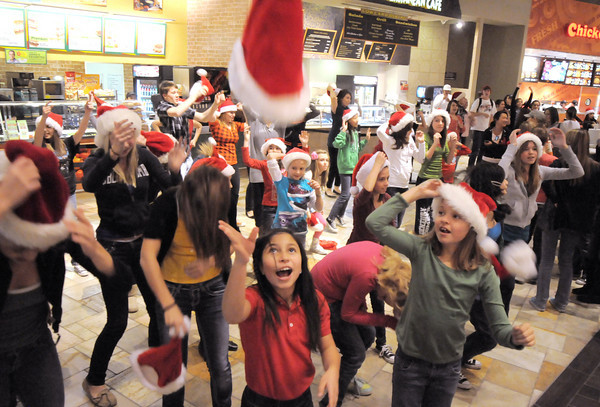 """With a toss of their hats over 200 dancers with Artistic Fusion Dance Academy and Break EFX gave the signal the flash mob was over after dancing to Mariah Carey's song """"All I want for Christmas is you"""" in the food court of FlatIron Crossing mall on Thursday. <br /> December  9, 2010<br /> staff photo/David R. Jennings"""