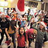 "With a toss of their hats over 200 dancers with Artistic Fusion Dance Academy and Break EFX gave the signal the flash mob was over after dancing to Mariah Carey's song ""All I want for Christmas is you"" in the food court of FlatIron Crossing mall on Thursday. <br /> December  9, 2010<br /> staff photo/David R. Jennings"