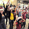 "Ashley Sullivan, 17, left, and Brooke Jones, 16, dancers with Artistic Fusion Dance Academy, helped lead a flash mob of over 200 people dancing to Mariah Carey's song ""All I want for Christmas is you"" surrounding shoppers in the food court of FlatIron Crossing mall on Thursday. <br /> December  9, 2010<br /> staff photo/David R. Jennings"