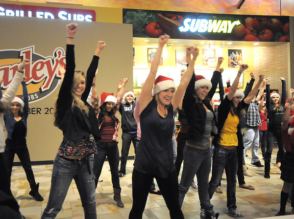 "Dancers with Artistic Fusion Dance Academy helped lead a flash mob of over 200 people dancing to Mariah Carey's song ""All I want for Christmas is you"" surrounding shoppers in the food court of FlatIron Crossing mall on Thursday. <br /> December  9, 2010<br /> staff photo/David R. Jennings"