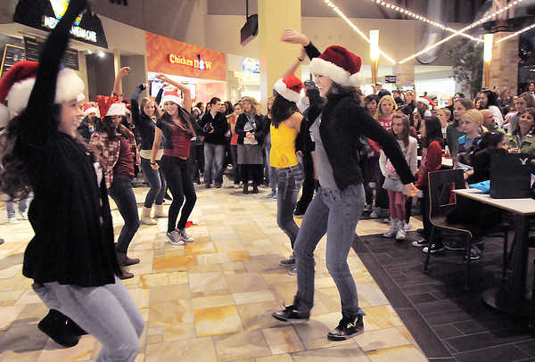 """Dancers from Artistic Fusion Dance Academy and  Break EFX  formed a flash mob of over 200 people dancing to Mariah Carey's song """"All I want for Christmas is you"""" for shoppers in the food court of FlatIron Crossing mall on Thursday. <br /> December  9, 2010<br /> staff photo/David R. Jennings"""