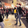 "Dancers from Artistic Fusion Dance Academy and  Break EFX  formed a flash mob of over 200 people dancing to Mariah Carey's song ""All I want for Christmas is you"" for shoppers in the food court of FlatIron Crossing mall on Thursday. <br /> December  9, 2010<br /> staff photo/David R. Jennings"
