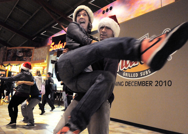 """Break EFX dancers Crista Lewis and Herb Neil begin dancing leading over 200 people to dance in a flash mob to Mariah Carey's song """"All I want for Christmas is you"""" in the food court of FlatIron Crossing mall on Thursday. Dancers in the flash mob were from Artistic Fusion Dance Academy and Break EFX Boulder/Denver. <br /> December  9, 2010<br /> staff photo/David R. Jennings"""