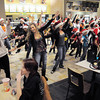 "Dancers from Artistic Fusion Dance Academy and  Break EFX  formed a flash mob of over 200 people dancing to Mariah Carey's song ""All I want for Christmas is you"" in the food court of FlatIron Crossing mall on Thursday. <br /> December  9, 2010<br /> staff photo/David R. Jennings"