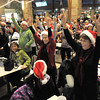 "Dancers and parents from Artistic Fusion Dance Academy and  Break EFX  formed a flash mob of over 200 people dancing to Mariah Carey's song ""All I want for Christmas is you"" surrounding shoppers in the food court of FlatIron Crossing mall on Thursday. <br /> December  9, 2010<br /> staff photo/David R. Jennings"