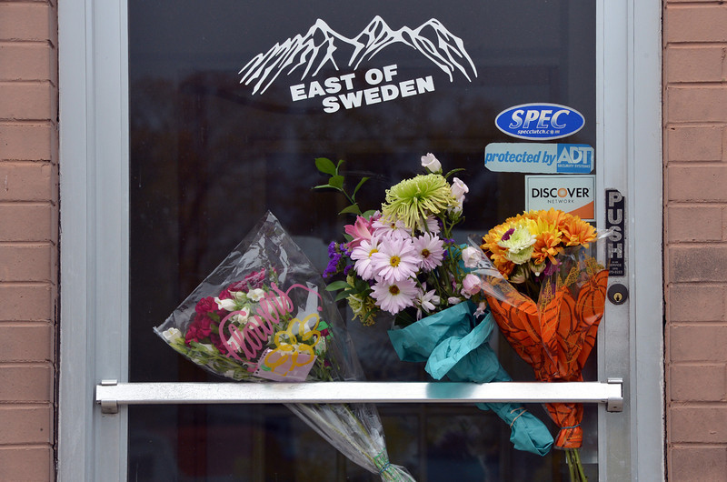 Flowers left on the front door by customers and friends of East of Sweden where employee, Mary McGrath was shot a killed on Friday.<br /> October 13, 2012<br /> staff photo/ David R. Jennings