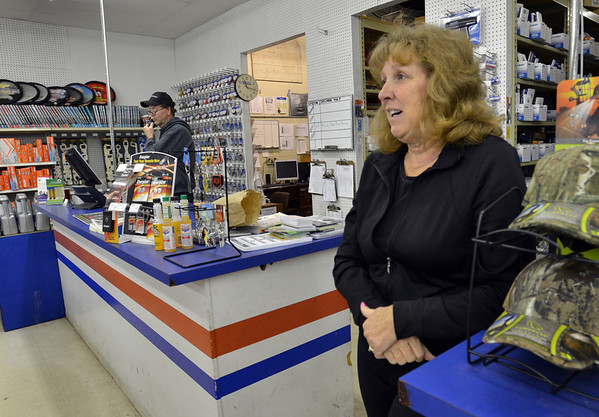 Pam Jenssen, right, with her husband Lee, left, employees of Carquest auto parts store, talk of their professional relationship to Mary McGrath an employee of East of Sweden who was shot a killed on Friday.<br /> October 13, 2012<br /> staff photo/ David R. Jennings