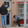 East of Sweden customers, who wished not to be identified, places flowers at the front door of the business in memory of Mary McGrath, an employee of the Saab repair shop, was shot a killed on Friday.<br /> October 12, 2012<br /> staff photo/ David R. Jennings