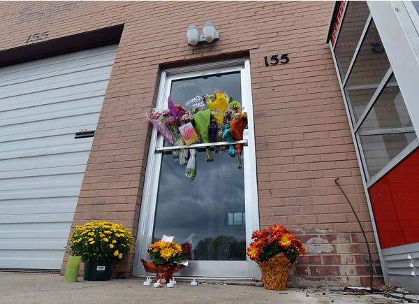 Flowers left on the front door by customers and friends of East of Sweden Saab repair ship where employee, Mary McGrath was shot a killed on Friday.<br /> October 13, 2012<br /> staff photo/ David R. Jennings