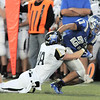 Broomfield's Jose Fraire is tackled by Monarch's Wes Moon during Friday's game at Elizabeth Kennedy Stadium.<br /> September 16, 2011<br /> staff photo/ David R. Jennings