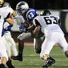 Broomfield's Jose Fraire runs downfield evading the tackle by  Monarch's Connor Fitzgerald during Friday's game at Elizabeth Kennedy Stadium.<br /> September 16, 2011<br /> staff photo/ David R. Jennings