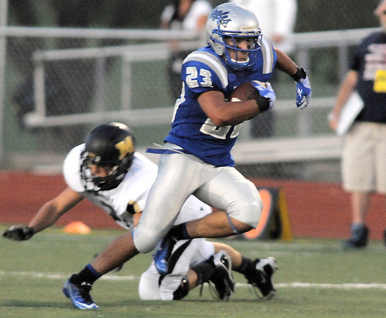 Broomfield's Jose Fraire runs downfield against Monarch during Friday's game at Elizabeth Kennedy Stadium.<br /> September 16, 2011<br /> staff photo/ David R. Jennings