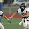 Monarch's Jared Meschke runs downfield with Broomfield's Jordan Hood in pursuit  during Friday's game against Broomfield at Elizabeth Kennedy Stadium.<br /> September 16, 2011<br /> staff photo/ David R. Jennings
