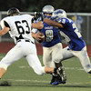 Broomfield's quarterback Angelo Perez perpares to run as Monarch closes in on him during Friday's game at Elizabeth Kennedy Stadium.<br /> September 16, 2011<br /> staff photo/ David R. Jennings