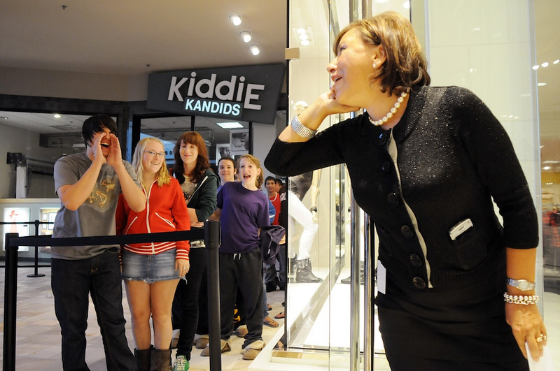An unidentified employee cheered the crowd on just before the doors opened to the 55,000 square foot Forever 21 store at FlatIron Crossing mall on Saturday.  <br /> August 1, 2009<br /> staff photo/David R. Jennings