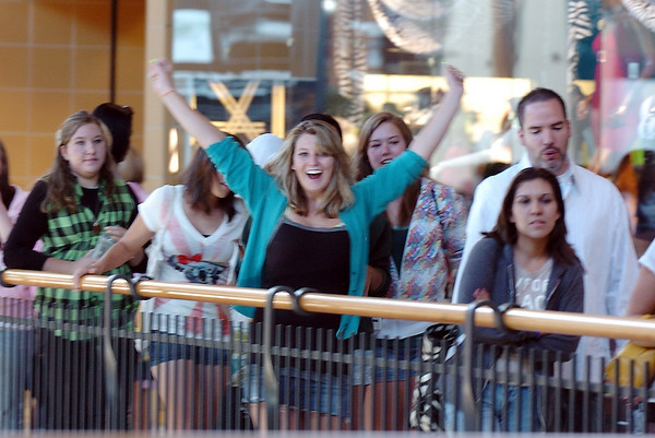 Christina Howard, 15, from Boulder, gives a big cheer as the line of people begins to move for the opening of Forever 21 store at FlatIron Crossing mall on Saturday.  The first 200 customers received gift cards ranging from $10 - $210. <br /> <br /> August 1, 2009<br /> staff photo/David R. Jennings