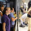 Erin Roberson, 17, center, Alexis Alme, 15, both from Longmont, and Sara Des Georges, 18, from Boulder, look at clothing on display as they stand in line for the opening of Forever 21 store at FlatIron Crossing mall on Saturday.  The first 200 customers received gift cards ranging from $10 - $210. <br /> <br /> August 1, 2009<br /> staff photo/David R. Jennings