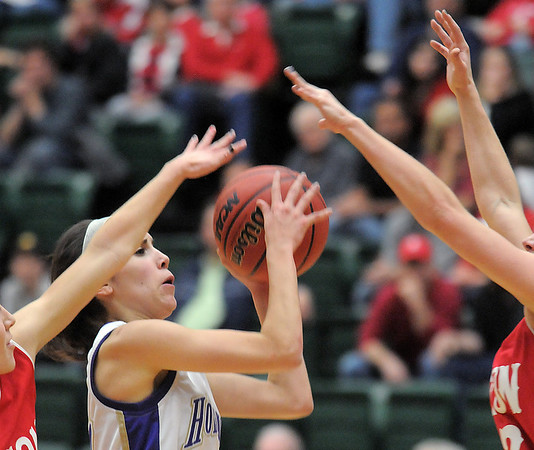 Holy Family's Carolina Gutierrez goes to the basket against Eaton during the 3A state championship game at Moby Arena in Ft. Collins  on Saturday.<br /> March 12, 2011<br />  staff photo/David R. Jennings