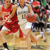 Holy Family's Taylor Helbig dribbles the ball downcourt against  Eaton's Leah Cheney during the 3A state championship game at Moby Arena in Ft. Collins  on Saturday.<br /> March 12, 2011<br />  staff photo/David R. Jennings