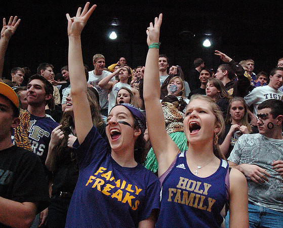 Dana Sanelli, left, and Rachel Anderson cheer for Holy Family giving the four peat sign during the 3A state championship game against Eaton at Moby Arena in Ft. Collins  on Saturday.<br /> March 12, 2011<br />  staff photo/David R. Jennings
